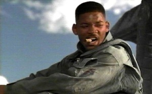Will Smith welcoming an alien to earth by smoking a big fat cigar over its unconscious body.