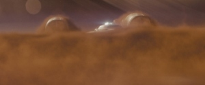 The Enterprise rising out of Titan's dust cloud.