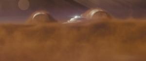 The Enterprise rising out of Titan's dust cloud.